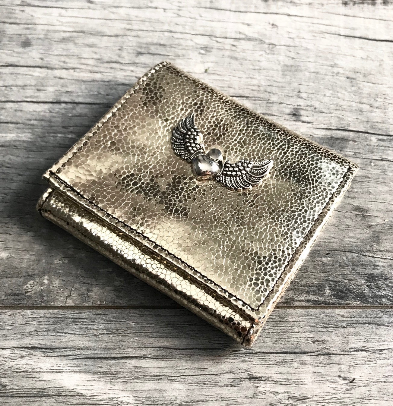 evileve chic mini leather wallet platinum