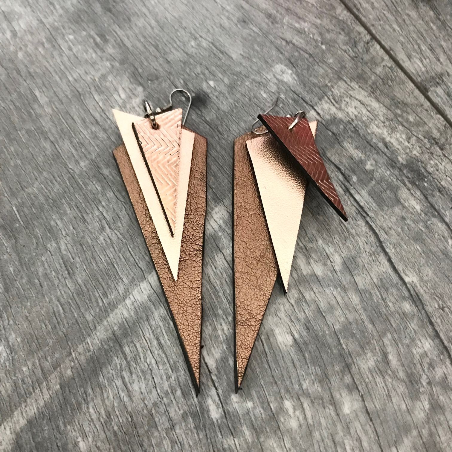 platinum dream evileve leather earrings