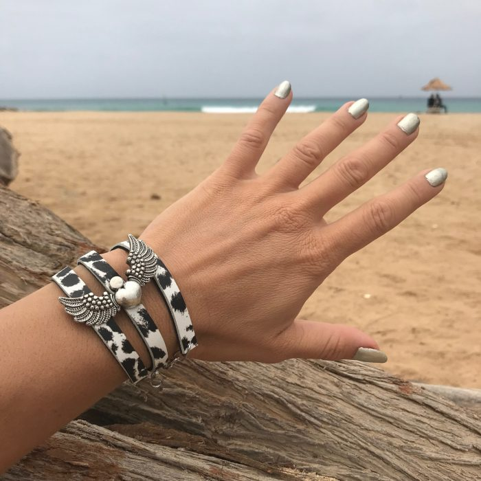 evileve angelwings blackandwhite leather bracelet