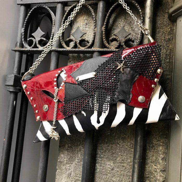 leather clutch burgundy zebra evileve