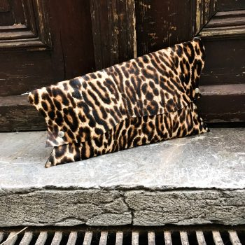tiger chic leather clutch evileve