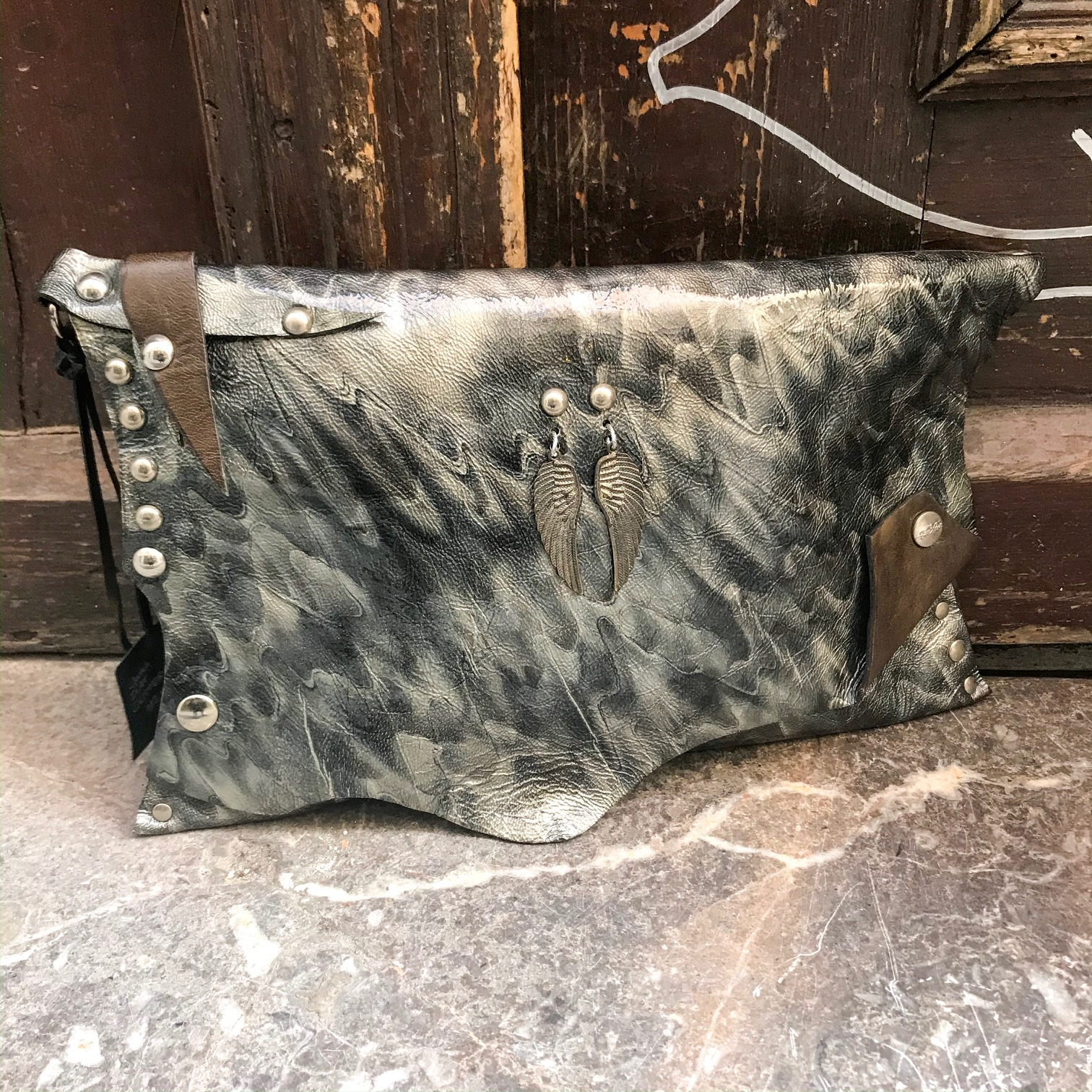 unique leather clutch pike wings evileve