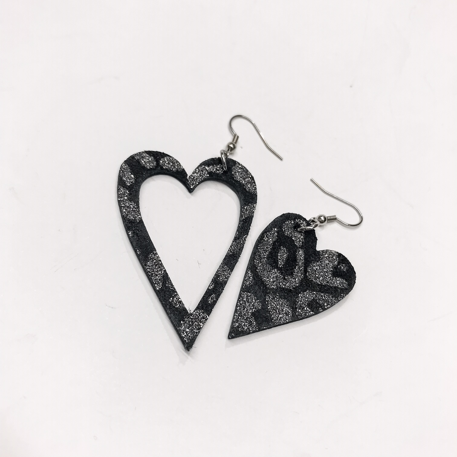 unique handmade leather and stainless steel earrings black tiger evileve