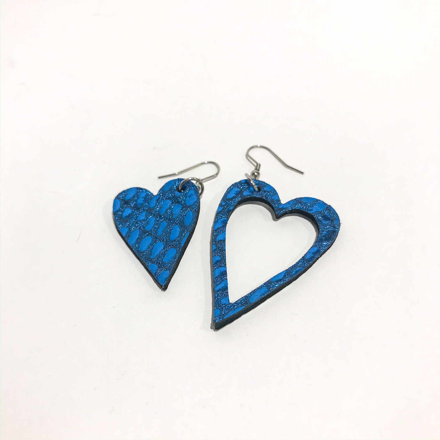 hearts deep blue leather and stainless steel earrings evileve