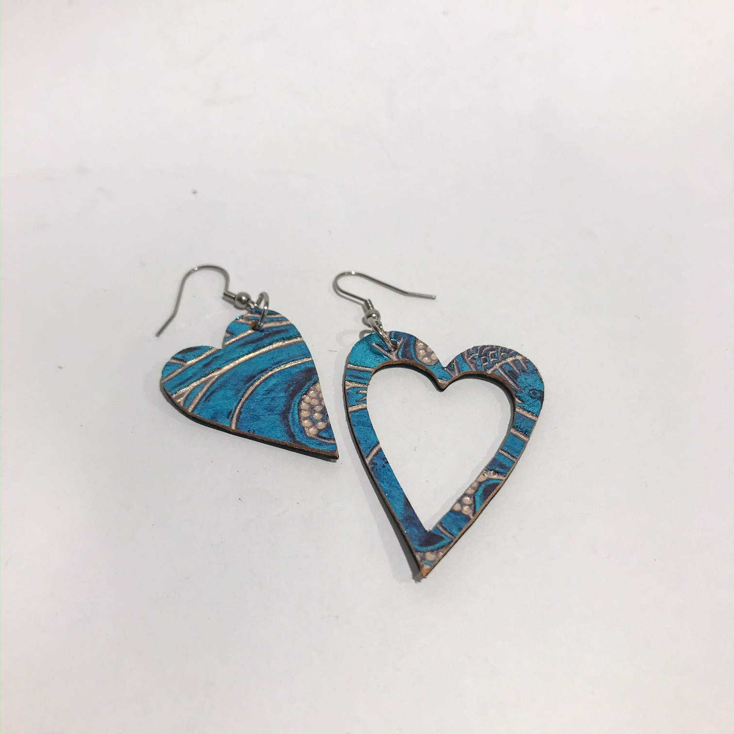 hearts caribbean blue leather and stainless steel earrings evileve