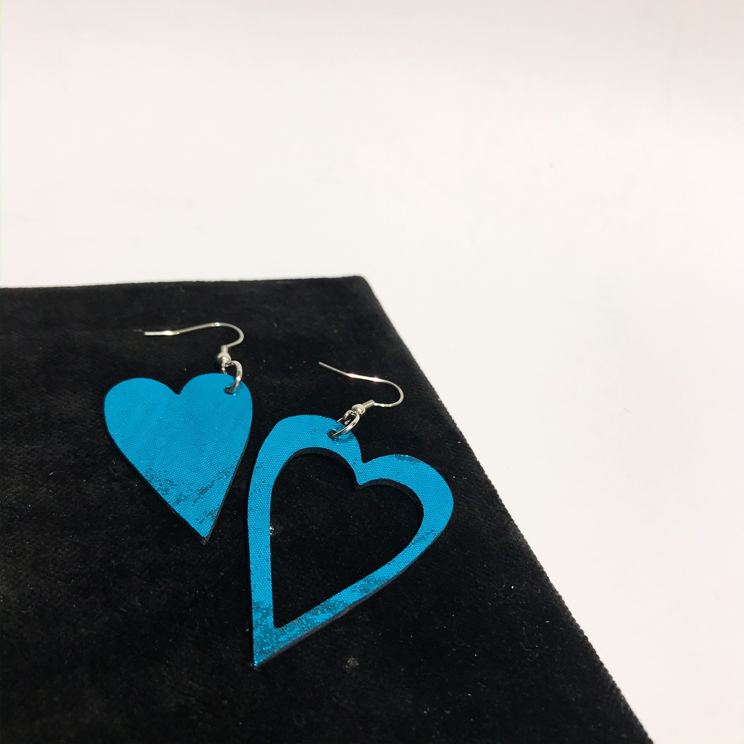 hearts caribbean glittery blue leather and stainless steel earrings evileve
