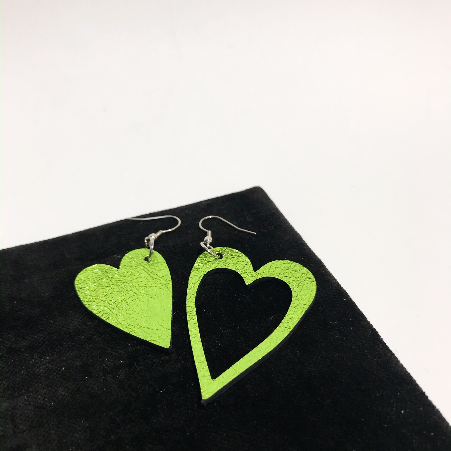 hearts lime green leather and stainless steel earrings evileve