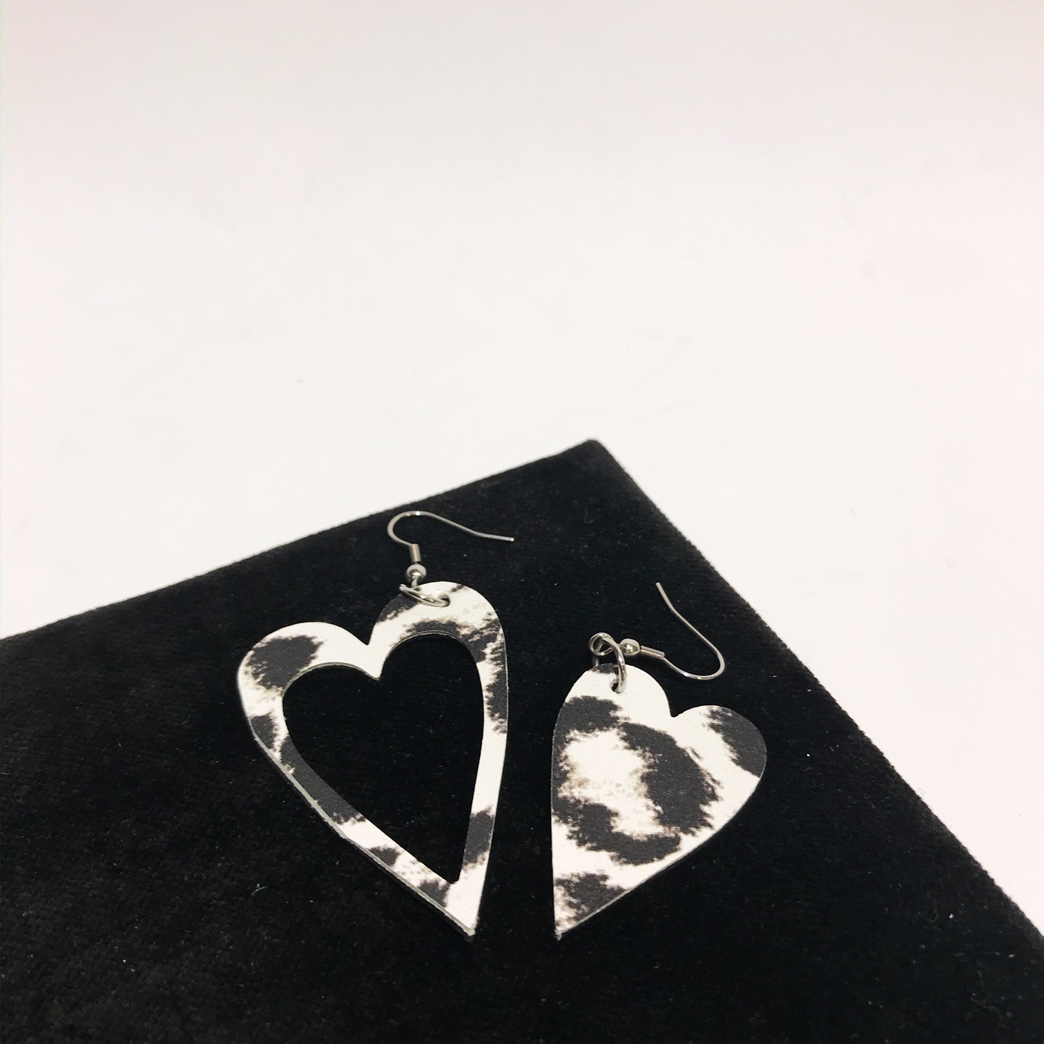 hearts black and white leather and stainless steel earrings evileve